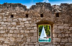 View Through Old Stone Window Atsailing Boat Royalty Free Stock Photography