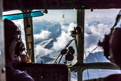 View throw Helicopter Cockpit Flying at High Altitude Mountain Pass Stock Photography