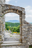 View thru the arch. Historical building and beautiful landscape Stock Image
