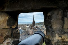 A view thru the cannon slot in Half Moon Battery, Edinburgh Castle. Scotland royalty free stock photos