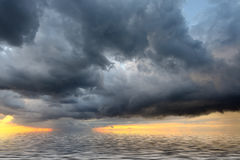 View of thunderstorm clouds above the sea. Stock Photo