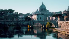 Iconic view from the Tiber on Ponte Sant`Angelo bridge and the St. Peter`s Basilica in Vatican, time lapse stock video