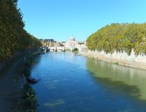 View of the Tiber in Rome taken from Ponte Umberto looking towards St. Peter's Basilica and Ponte Sant'Angelo royalty free stock photography