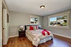 View of tidy bedroom with hardwood floor Royalty Free Stock Photography