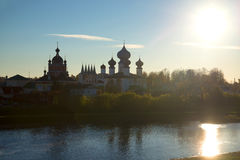 View of the Tikhvin Deiparous Uspensky monastery from the river Tikhvinki at sunset. Tikhvin Royalty Free Stock Photos