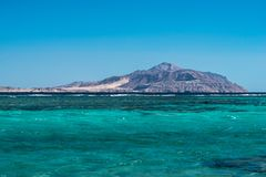 View of Tiran Island from Red Sea in Sharm El Sheikh, Egypt. View of Tiran Island from Red Sea in Sharm El Sheikh, Egypt Royalty Free Stock Photos