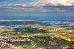View from Titano mountain at Italian neighborhood and the sea Stock Photography