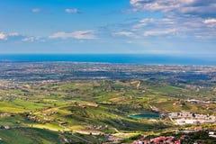 View from Titano mountain at Italian neighborhood and the sea Stock Photos