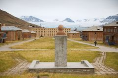 View to abandoned Russian arctic settlement Pyramiden with the bust of Lenin in the foreground in Pyramiden, Norway. Royalty Free Stock Images
