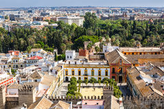 View to  Alcazar Gardens and palaces in Seville. Sevilla, Spain - September 09, 2015: View to  Alcazar Gardens and palaces in Seville from Giralda tower high Stock Photo