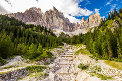 View to Alpine brook, Dolomites mountains, Italy, Europe Stock Photos