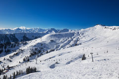 View to Alpine mountains and ski slopes in Austria from famous K Stock Images