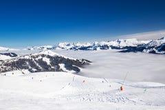 View to Alpine mountains and ski slopes in Austria from famous Kitzbuehel ski resort Stock Image