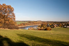 View to Altensalz village with meadow, colorful autumn trees and Pohl water reservoir Stock Photo