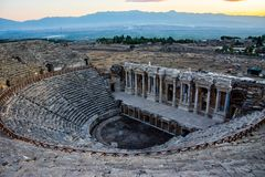 View to the amphitheater from the Greek- Roman period in Pamukka. View to the amphitheater from the Greek-Roman period in Pamukkale valley in Denizli Stock Image
