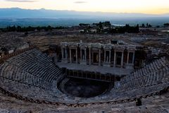 View to the amphitheater from the Greek- Roman period in Pamukka. View to the amphitheater from the Greek-Roman period in Pamukkale valley in Denizli Stock Photo