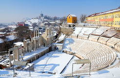 View to ancient amphitheater in Plovdiv. Winter cityscape of Plovdiv with ancient roman amphitheater covered in snow Stock Photos