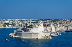 View to the Ancient limestone walls and towers of Fort St Angelo. From Upper Barrakka Gardens, view across the Grand Harbor, Valletta, Malta Stock Images