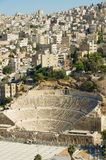 View to the ancient Roman theatre with the residential area buildings at the background in Amman, Jordan. Stock Photo