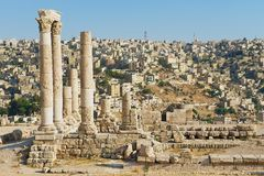 View to the ancient stone columns at the Citadel of Amman with the Amman city at the background in Amman, Jordan. Stock Photo