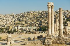 View to the ancient stone columns at the Citadel of Amman with the Amman city at the background in Amman, Jordan. Royalty Free Stock Photography