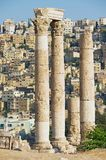 View to the ancient stone columns at the Citadel of Amman with the Amman city at the background in Amman, Jordan. Royalty Free Stock Images