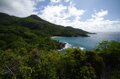View to Anse Major, Seychelles. View from hiking trail along the coast to Anse Major or Anse Jasmin, path on granite rocks in  tropical Paradise at the north Royalty Free Stock Photo