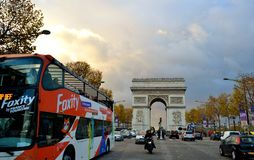 View to Arc de Triomphe and the Paris city traffic in autumn. Royalty Free Stock Photos