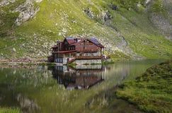 View to Balea Lake cottage near Transfagarasan highway in the Ca. Rpathian Mountains, Romania, Eastern Europe stock images