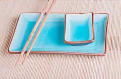 View to bamboo mat, dish and chopsticks Royalty Free Stock Photography