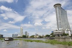 View to the Bangkok city buildings from the Chao Phraya River in Bangkok, Thailand. Stock Images