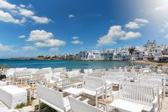 View to the beach of Naousa with tables and benches on the island of Pasros Royalty Free Stock Images
