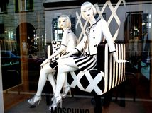 View to beautiful models exposed in Milan Moschino fashion boutique. Royalty Free Stock Images