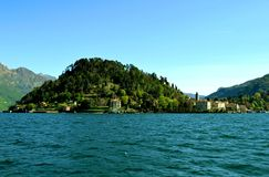 View to Bellagio peninsula from ferry in spring sunny day. Stock Image