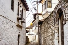 Unique architecture of Berat. View to Berat, historic city in the south of Albania, during a sunny day. Tiny stone streets and white houses built on a high hill Royalty Free Stock Images
