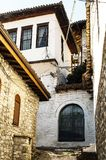 Unique architecture of Berat. View to Berat, historic city in the south of Albania, during a sunny day. Tiny stone streets and white houses built on a high hill Royalty Free Stock Image