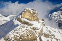 View to the Birg cable car station from the cable car gondola on the way to Schilthorn in Murren, Switzerland. Royalty Free Stock Image
