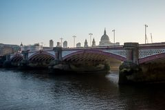 A view to Blackfriars Bridge and St Paul``s Cathedral early in the morning. A view to Blackfriars Bridge and St Paul`s Cathedral early in the morning, London Royalty Free Stock Images