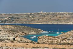 Blue Lagoon, Comino Malta. View to the Blue Lagoon with the island of Gozo in the background Royalty Free Stock Photo