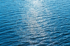 View to blue water with reflections Royalty Free Stock Image