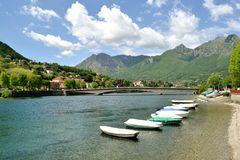 View to boats anchored at Lecco lakefront in summer sunny day. Stock Photos