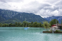 View to boats near shores of Brienz Lake Stock Photography