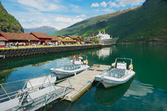 View to boats tied at the Flam railway station pier in Flam, Norway. Royalty Free Stock Photography