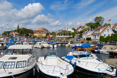 View to the boats tied at the harbor in Frogn, Norway. Stock Photos