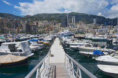 View to the boats tied in the Monte Carlo harbour, Monaco. Stock Photos