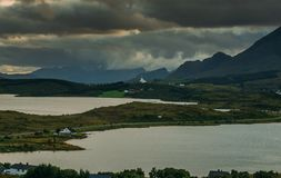 View to Bostad church and mountains, Lofoten Islands. Norway royalty free stock photography