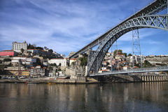 View to the bridge across the river and old European architectur. E on opposite shore Royalty Free Stock Photos