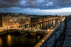 The view to the bridge of Lomonosov over the river  Fontanka in Stock Images