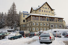 View to the cars parked in front of the Waldhaus am See hotel in Saint Moritz, Switzerland. Royalty Free Stock Photography