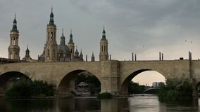 Cathedral Basilica of Our Lady of Pillar with bridge and Ebro river Zaragoza